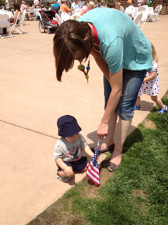 A youngster touches a U.S. Flag that was part of the festive decorations at the Stanley Hotel for the July 4 Old Glory Carnival.
