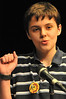 Josh Bradford shows almost as much enthusiasm as relief after repeating as the Estes Park Middle School's Spelling Bee Champion on Friday. Bradford defeated students from grades 5-8 to claim his second title.