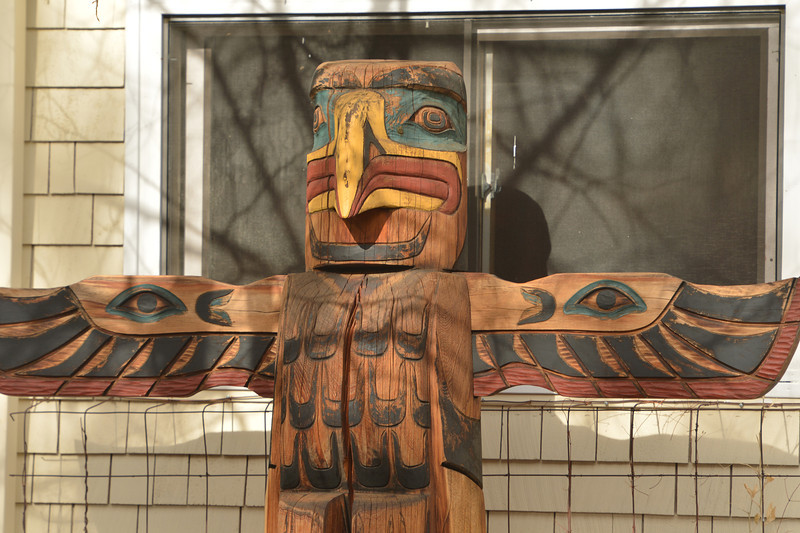 An eagle tops a totem pole near MacGregor Avenue on Wednesday. While beautiful and intriguing, the artwork also holds spiritual significants to the native tribes of the Pacific Northwest.