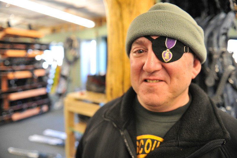 Dan Shannon of West Cliff, Colo. wears a Purple Heart eye patch at the Estes Park Mountain Shop on Monday. Shannon, who served many years in the US Army, and 20 other wounded veterans, mostly from Fort Sam Houston, were at the shop to get fitted with shoes and boots to enjoy the week out in the Colorado high country.