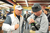 Mike Lage and Bobby Henline, both from San Antonio, Texas, help each other with outdoor equipment at the Estes Park Mountain Shop on Monday. The former soldiers were visiting with the Challange Aspen Military Opportunities, an organization that offers wounded warriors outdoor recreation opportunities.