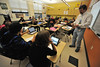 Middle school students show their quiz game answers to science teach Joe Frey on Wednesday. Students and teachers are enjoying new and fun ways to learn with their iPads.