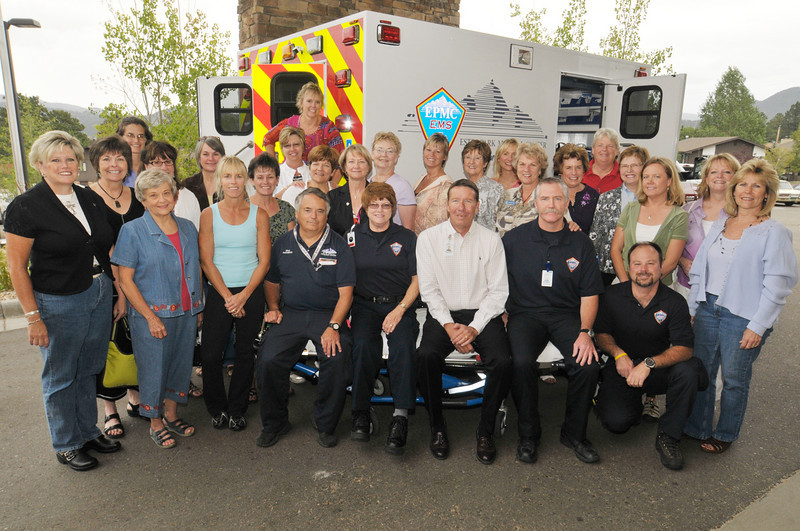 Photo by Walt Hester<br /> Ladies of the Quota Club and EMTs of the Estes Park Medical Center sit next to the new ambulance on Friday. This is the 14th ambulance the organisation has purchased for the medical center.