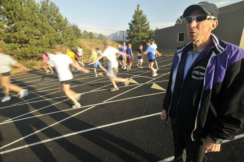 Photo by Walt Hester<br /> Estes Park Cross Country coach Bill Ruth runs the high school and middle school teams through their warm up at Bobcat Stadium on Tuesday. Ruth, a former Ironman triathlete, finished the Leadville 100 mountain bike race on Saturday.