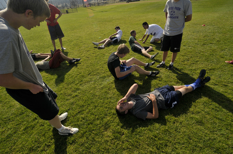 Photo by Walt Hester<br /> Members of the Estes Park High School soccer team suffer through the second day of practices, including sprints and abdominal exercises, at the Stanley Park ball fields on Tuesday.
