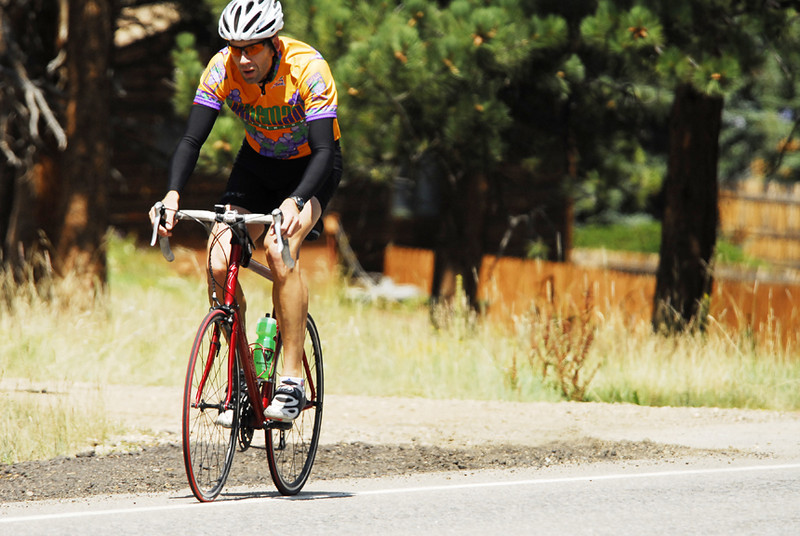 Photo by Walt Hester<br /> A cyclist riding the SPAN the Rockies metric double-century, about 120 mile, grinds up S. St. Vrain Avenue on his return trip to Boulder. The ride was a fund raiser for Safehouse Progressive Alliance for Non-Violence.