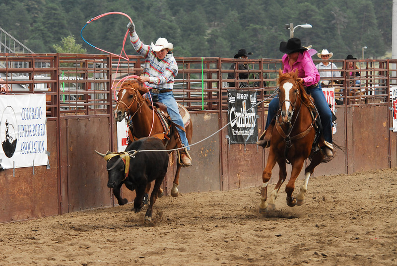 Photo by Walt Hester<br /> Cody Lane, left, of Fairplay, and Shiha Arnold of Strausburg, team roping on Saturday.