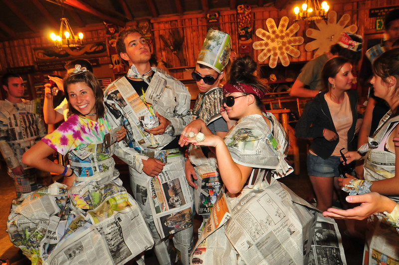 Photo by Walt Hester<br /> Kids at the Cheley Camp pose in their original designs made from the pages of the Trail-Gazette on Friday. The newspaper-outfits were part of a team work exercise for the teens attending a leadership camp.