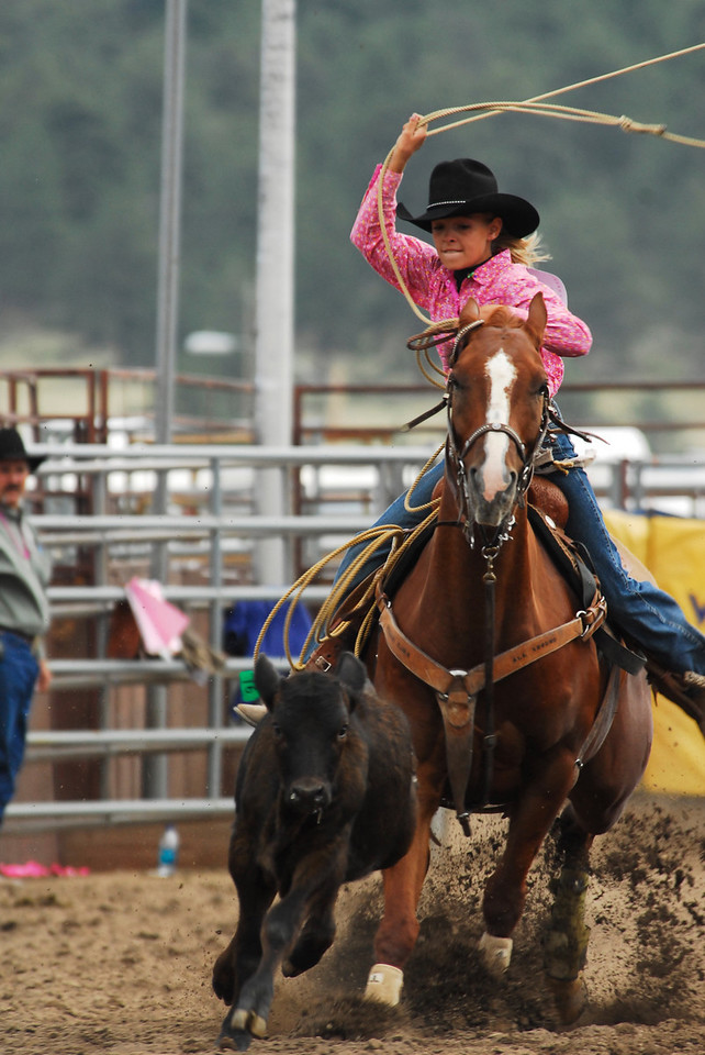 Photo by Walt Hester<br /> Teisha Coffield, 14, of Yuma chases down a calf during Girls Break Away Roping on Saturday.