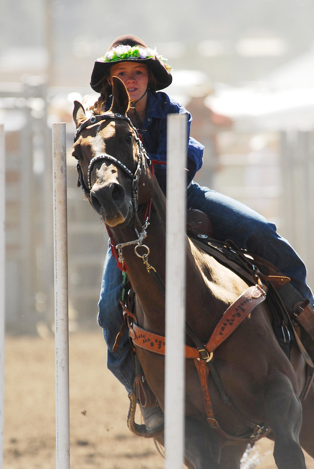 Photo by Walt Hester<br /> Kelly Palmer of Parshall, CO, Pole Bending.