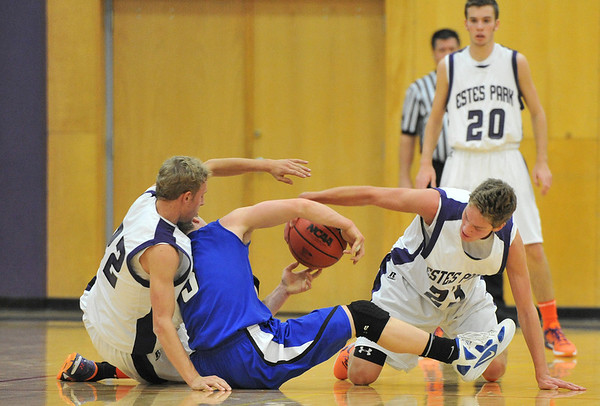 Andrew, and Isaak Cirone harrass the Cougars' Wyatt Simon on Tuesday. The Resurrection Christian guard gave the Bobcats fits, scoring 20 points.