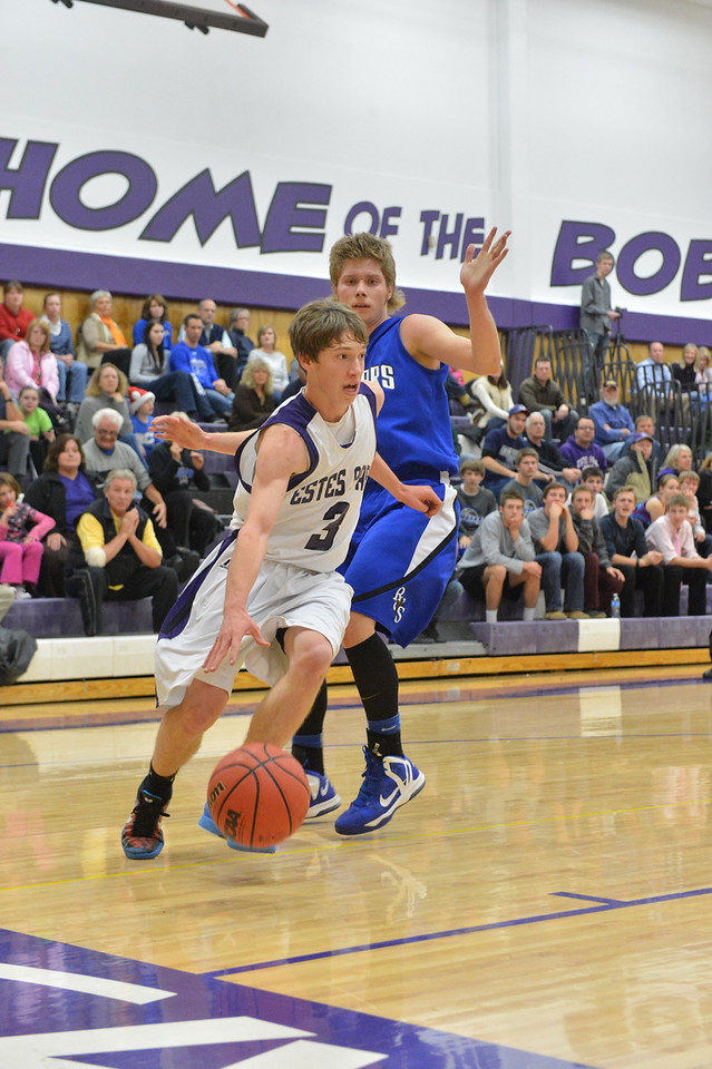 Zach Pierce works around Resurrection Christian's Jake Lohr early in the Tuesday matchup. Pierce worked hard and contributed four points and two rebounds.