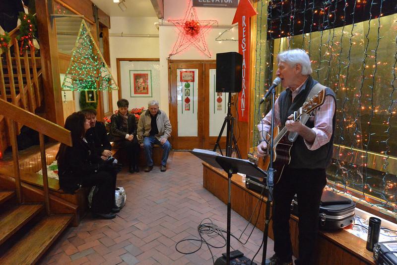 Local artist Dick Orleans entertains visitors to the Park Place Mall on Saturday. As the holiday season ramps up, shops are doing more to draw visitors in.