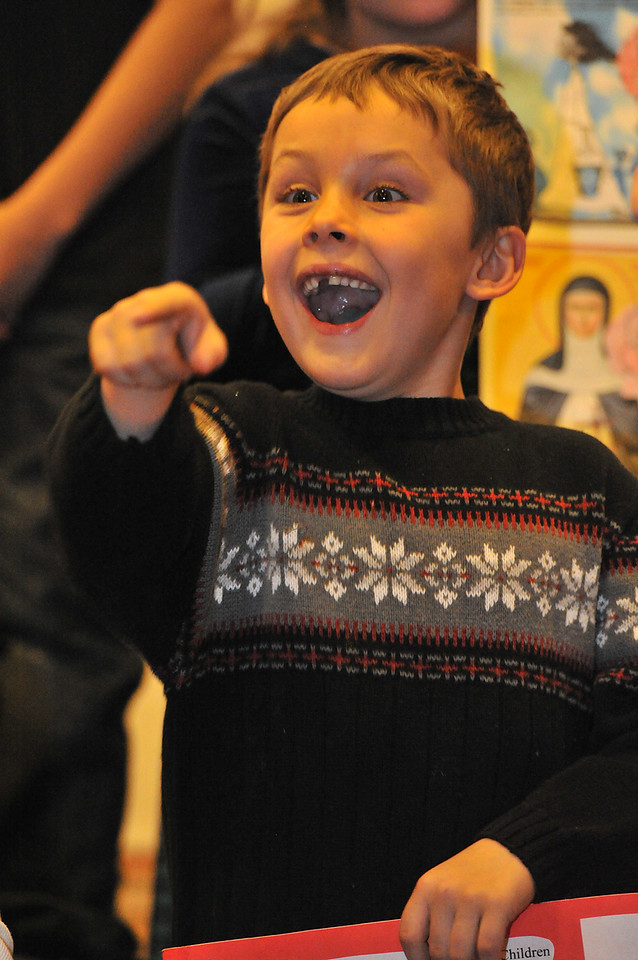 Aiden Danton, 6, spots Saint Nick at Our Lady of the Mountains Catholic Church on Sunday. The famous saint appeared after the church's annual Christmas pageant.