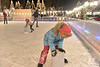 Anna Greenway of Estes Park pushes a bucket around the well-lit Estes Park ice rink on Saturday night. Lights and enthusiasm arer keeping the rink open after sundown on weekends.