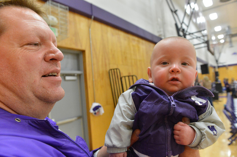 John Laughlin holds his young son, Cade, at the boys basketball game on Tuesday. Laughlin is married to Sara Laughlin, principal of the High School and Middle School in Estes Park.
