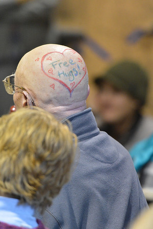 A St. Baldrick's fan displays a little artwork on Sunday. Face and head painting was offered for shavees and supporters.