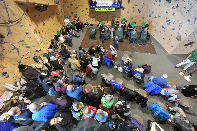 A crowd jams in to see the St. Baldrick's Day fund raiser at the Estes Park Mountain Shop on Sunday. While the Mountain Shop has organized the event for a decade, this is the first year the shaving has occured at the shop, itself.