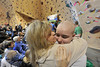 Carleigh Chrastil, 13, enjoys a congratulatory hug from mom, Natalie, at the annual St. Baldrick's Day fund raiser for childhood cancer research at the Estes Park Mountain Shop on Sunday. Carleigh has participated in the event since she was in elementary school.
