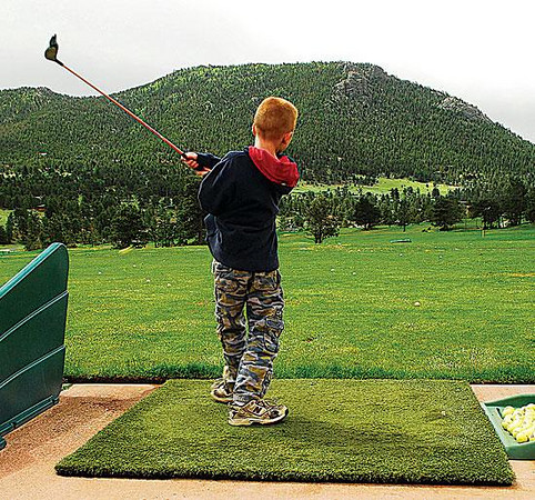 "Adrial Fisher, 9, holds his ""Golfer Pose,"" holding his backswing for three seconds at the Estes Park 18-hole course on Monday. Photo by Walt Hester."