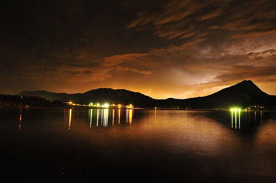 A severe thunderstorm lights up the sky over Lake Estes on Monday Night. The system dumped heavy rain around Allenspark before moving out over the eastern plains and producing tornadoes. Photo by Walt Hester