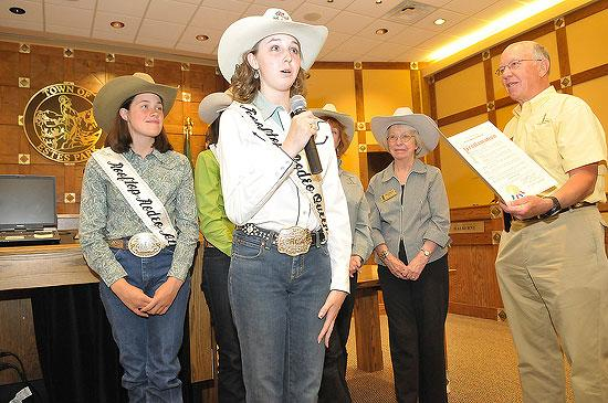 Rooftop Rodeo Queen Ashlie Murray addresses the town board meeting at Town Hall on Tuesday. Mayor Bill Pickham presente a proclamation to the Rooftop Rodeo Committee designating July 7 - July 12 as Rodeo Week in Estes Park. Photo by Walt Hester