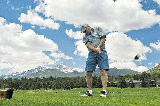 Fore! Troy Ray of Gunbarrel City, Texas drives off the first tee at the Estes Park Golf Course on Thursday. Photo by Walt Hester