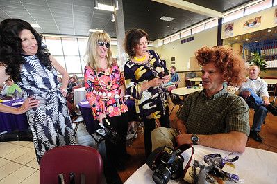 Walt Hester | Trail Gazette Retiring administrative staff play Charlie's Angels and pick on fellow retiree John Christopher at the district's staff recognition night. Linda Chapman, Ruth Miller and Nancy Brown will all retire after the end of this school year.