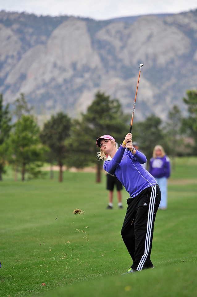 Walt Hester | Trail Gazette<br /> Jesse O'Dell drives to the green during Wednesday's Estes Park Invitational golf tournament at the public 18-hole course. O'Dell placed third among individuals and two of the top four teams were Estes Park teams.