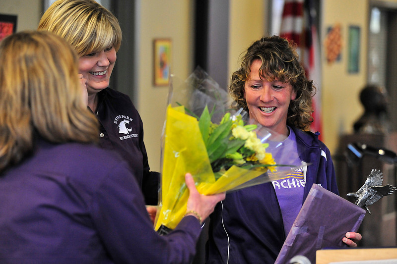 Walt Hester | Trail Gazette<br /> Kay Hays takes flowers, accolades and recognition as the R3 district's Classified Employee of the Year on Wednesday. Hays is a secretary at the Estesd Park Elementary School and coaches both the boys and girls soccer teams.