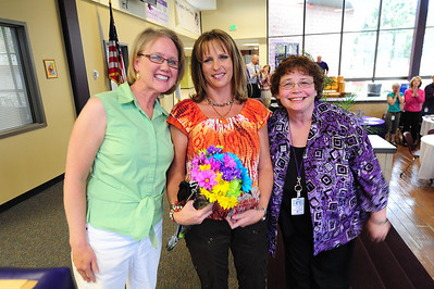 Walt Hester | Trail Gazette Elementary School librarians Lisa Wahler and Debbie Holmes flank Sarah Pearson at Wednesday evening's R3 school district recognition night. Pearson was honored as the district's Community Sevice to Education Award winner.