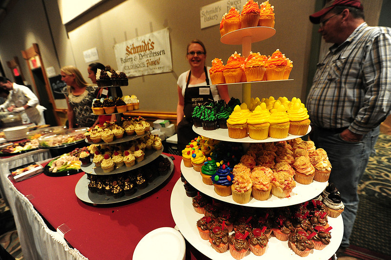 Walt Hester | Trail Gazette<br /> A colorful variety og cupcakes rises from the Sweet Peaks table. Every year, one or two new shops or restaurants appear at the Taste of Estes.