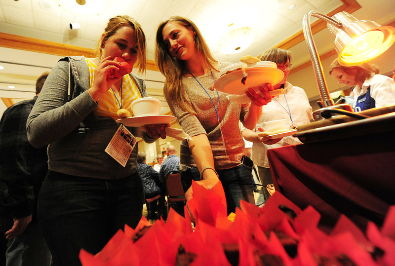 Walt Hester | Trail Gazette<br /> Raye Good of Estes Park and Jessica Cole of Baton Rouge enjoy treats from the YMCA. The variety of dishes ranges from prime rib and lasagna to cookies, cupcakes and brownies.