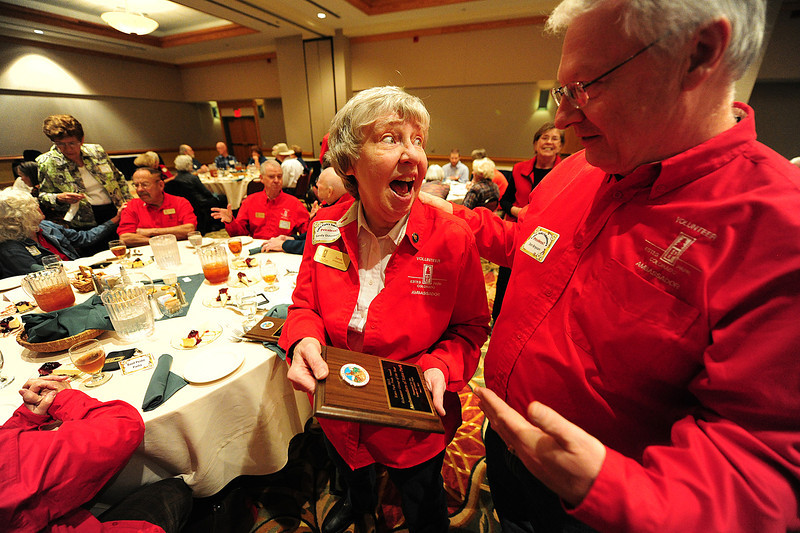 Walt Hester | Trail Gazette<br /> VolunteerSandy Osterman shows off one of two awards she picked up at the Esres Park Volunteer Recognition Luncheon on Tuesday. Osterman was named co-volunteer of the year along with Claudia Erwin, and the red-shirted Ambassedors were named organization of the year.