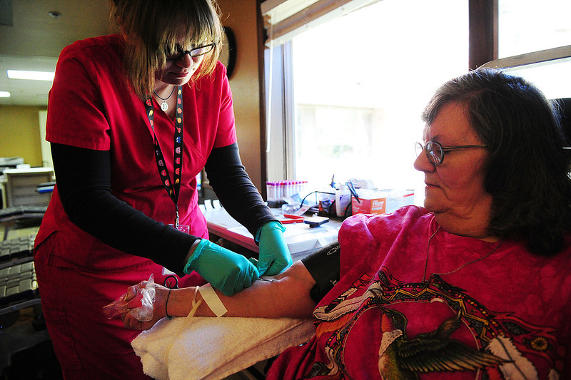 Walt Hester | Trail Gazette<br /> Catherine Eastep of Estes Park donates blood with the help of SamiJo Mcqison during the Blood Drive at the Estes Park Medical Center on Monday. The blood drive returns in September.