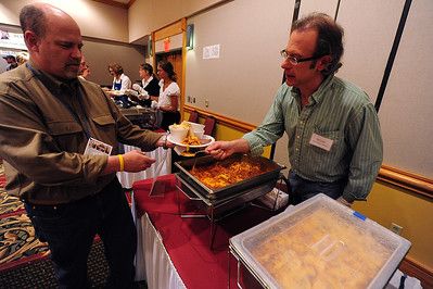 Walt Hester | Trail Gazette Mayor Pro Tem Chuck Levine gets a heling hand, or fork, from Rob Pieper at the Taste of Estes on Thursday. Visitors enjoy the diverse variety of dishes served at the event, from lasagne to cupcakes.