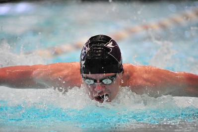 Walt Hester | Trail Gazette Estes Park's Forrest Beesley swims the 100-yard butterfly in March. Beesley is back from a foot injury and qualified for May's state swim meet in the 100 fly.
