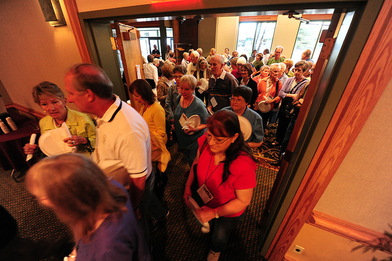 Walt Hester | Trail Gazette<br /> Fans of food rush into the Estes Park Conference Center on Thursday. The Quota Club's annual Taste of Estes is one of the most popular events among locals.
