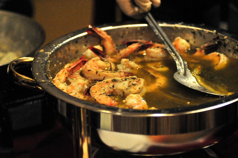 Walt Hester | Trail Gazette<br /> Shrimp scampi simmers on Thursday. While some restaurants prepared dishes ahead of time, some brought all they needed to prepare their dishes at the event.