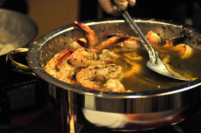 Walt Hester | Trail Gazette Shrimp scampi simmers on Thursday. While some restaurants prepared dishes ahead of time, some brought all they needed to prepare their dishes at the event.
