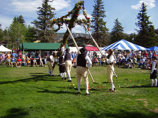 The Maypole goes up in Bond Park to commemorate the beginning of the Scandinavian Mid-summer Festival.