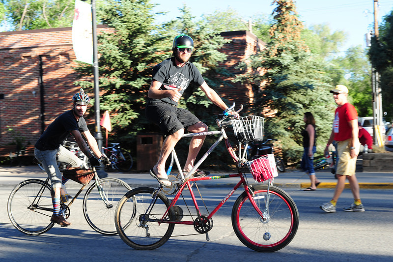 Walt Hester | Trail Gazette<br /> Cyclists wheel through Carbondale on Monday night. Cyclists often use their rides as a statement about themselves, like the home-made double bike or the fixed-gear bike, left.