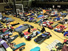 Cyclists curl up in the Lake County High School gym on Tuesday night. They are trying forest up before Wednesday's 93-mile ride from Leadville to Granby, the RTR's longest day.