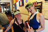 Walt Hester | Trail Gazette<br /> Friends Amanda, from Avon, and Nadine, from Eagle, clown around in a coffee shop in Carbonedale. The pair are riding for a serious reason, raising money for the Davis Phinney Foundation, which advocated for victims of Parkinsons Disease.