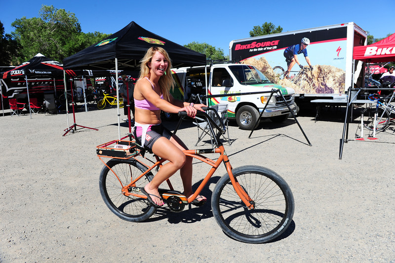 Walt Hester | Trail Gazette<br /> Megan Monroy of Long Beach, Calif. tools around on her beach cruiser after a day on her road bike. No matter where they are from or how hard they ride, Ride the Rockies cyclist share a deep love of cycling.
