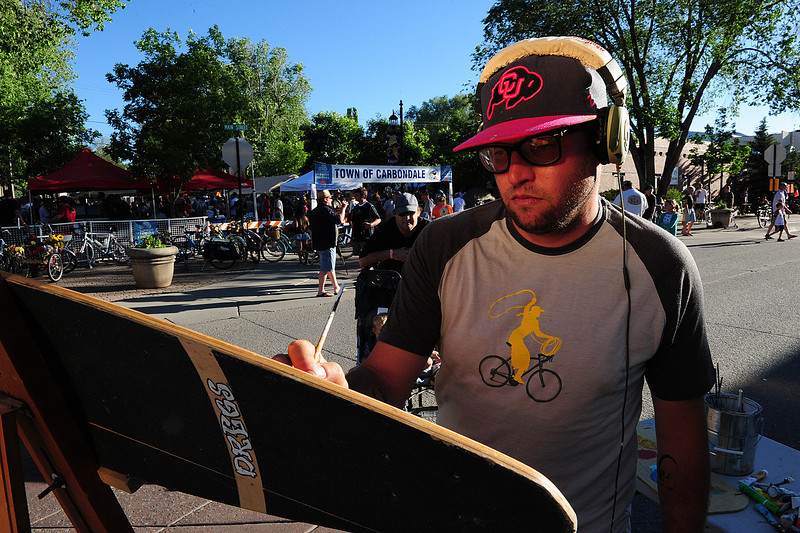Walt Hester | Trail Gazette<br /> Artist Stanley Bell paints foud objects outside the Carbondale Ride the Rockies celebration. The ride inspires lots of people in many different ways.