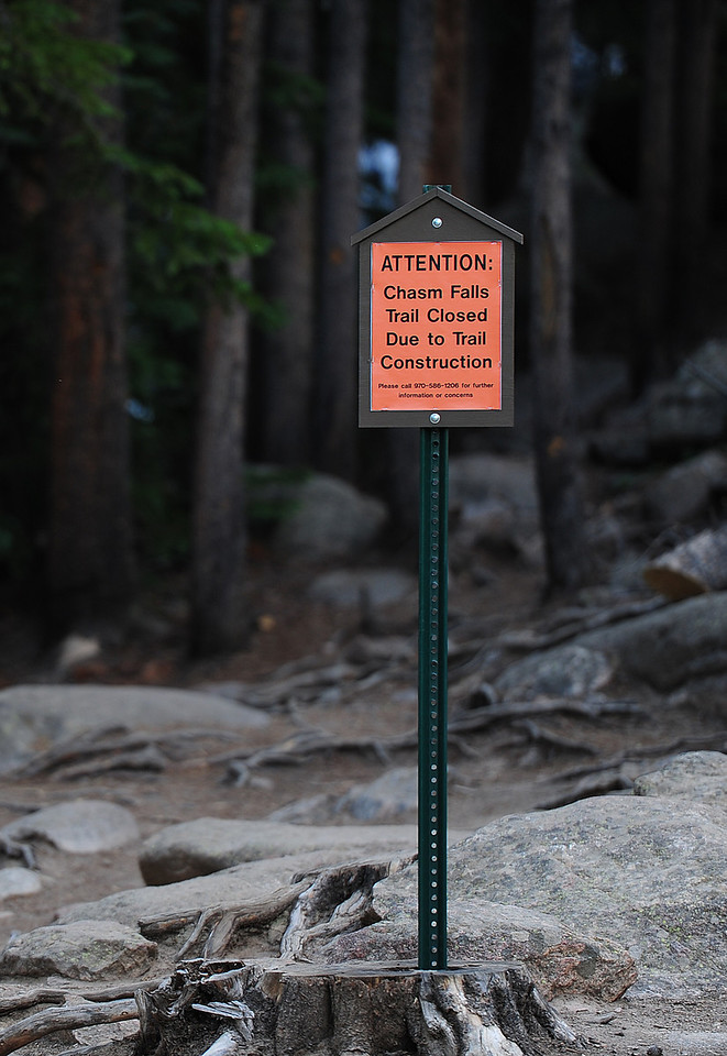 Walt Hester | Trail Gazette<br /> A sign informs possible hikers that a favorite trail is not an option along the Old Fall River Road on Wednesday. The Chasm Falls Trail should reopen in July.