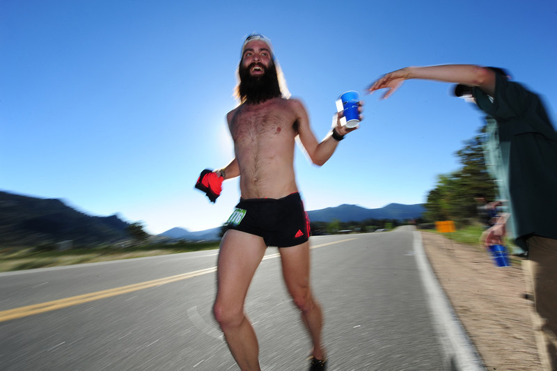 Walt Hester | Trail Gazette<br /> Ultra-distance runner Kendrick Callaway takes water at the Mary's Lake aid station during Sunday's Estes Park Marathon. Callaway finished fifth overall and had cut his milage down for the week from 115 miles.