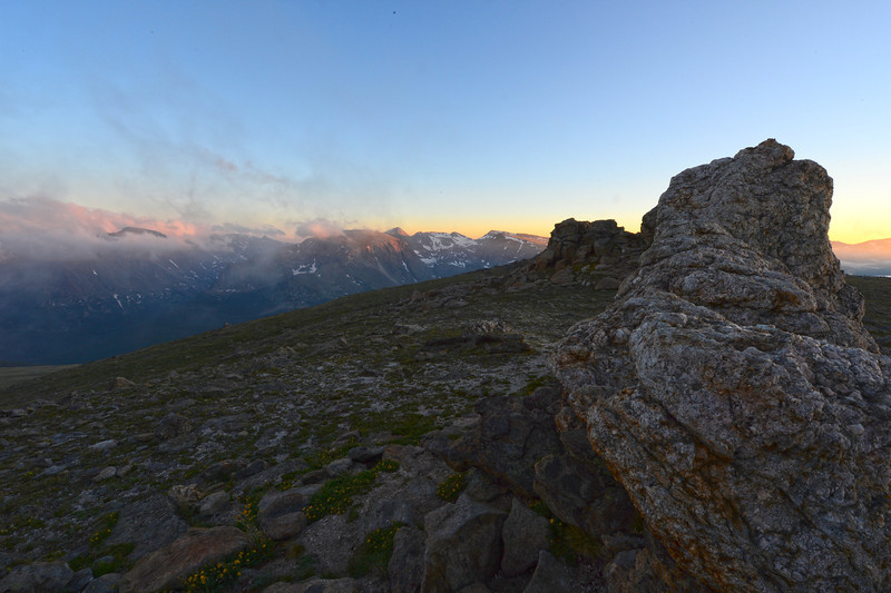 Walt Hester | Trail Gazette<br /> The first sunset of summer paints the peaks of the Continental Divide, while light fades along the top of Trail Ridge on Wednesday. Summer officially arrived Wednesday evening, while the summer temperatures should return Friday and Saturday.