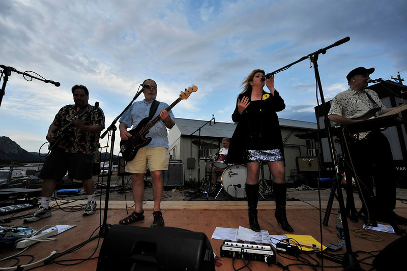 Walt Hester | Trail Gazette<br /> Local Estes Park rockers Amplified Soul play at the Stanley Fair Grounds on Thursday night. In spite of rain, riders and locals made it out to hear the bands and enjoy the food for the Ride the Rockies festivities.